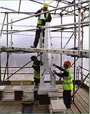 Workers from E. Bowman & Sons add the finishing touches to one of the pinnacles�